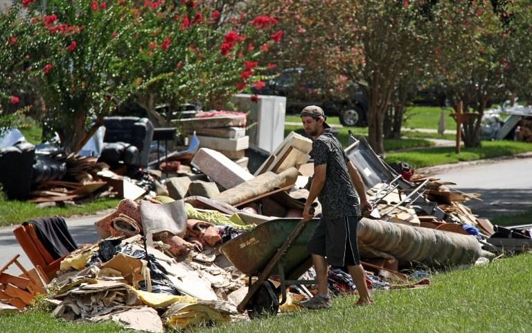 Residents of Baton Rouge piled up damaged belongings during cleanup efforts. (Ken Durden/Shutterstock.com)