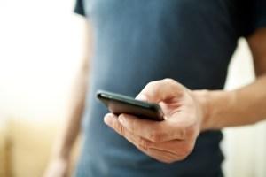 man on smartphone app